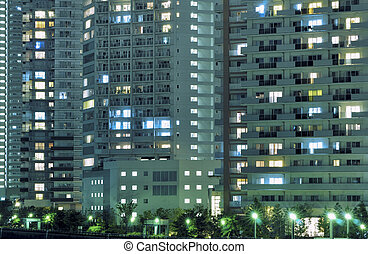 modern city - night residential building with many windows ...