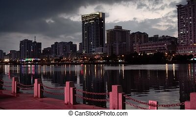 modern city on the river at dusk