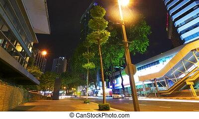 Modern city street at night, timelapse in motion