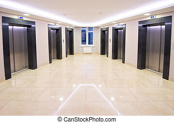 Modern clean elevator hall of apartment buidling. Marble ...