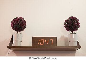Modern clock with numbers in interior of living room