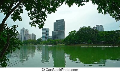 """Modern, Commercial, Highrise Buildings over an Urban Lake..."