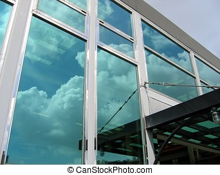 Modern Company Building - -- with the sky reflecting in the...