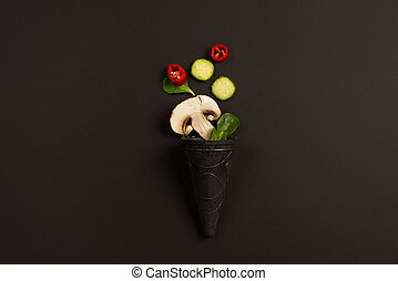 Modern composition concept with vegetable on dark background