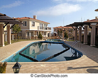 modern condominiums with swimming pool.