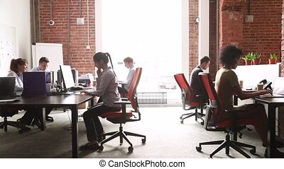 Modern corporate office with multicultural staff employees...