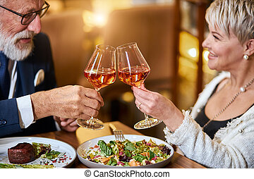 Modern couple have dinner and celebrate in restaurant