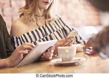 Modern couple using wireless technology
