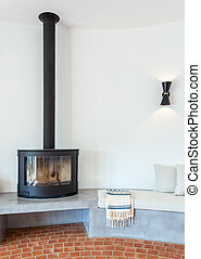Modern cozy living room with fireplace inside. Towel. Lamp...