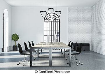 Modern cozy loft interior coworking space with arched window, light brick wall and grey floor