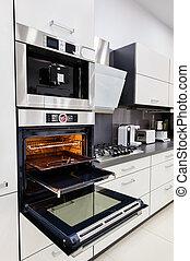 Modern luxury custom hi-tek black and white kitchen, clean interior design, focus at oven with open door