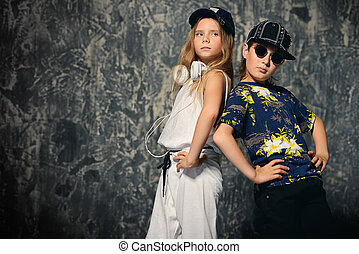 modern dance team - Two cool modern kids posing together in...