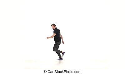 Modern dancer dancing brake-dance move, white, slow motion