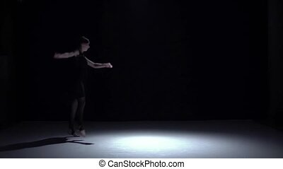 Modern dancer girl in dark dress continue dancing contemporary on black, shadow, slow motion