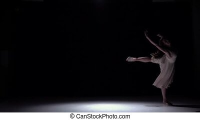 Modern dancer girl in white dress dancing contemporary, jumps on black, shadow, slow motion