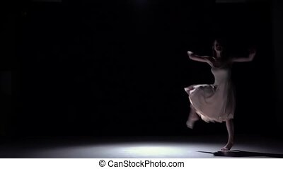 Modern dancer girl in white dress continue dancing contemporary on black, shadow, slow motion