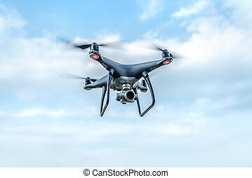 Modern dark drone in the sky.