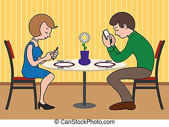 Modern Date - Couple on a date are looking at their phones...