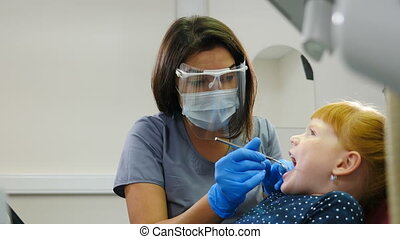Modern dentist office. Close-up shot of female dentist ...