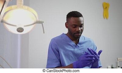 Modern dentistry clinic. Young handsome African man doctor ...