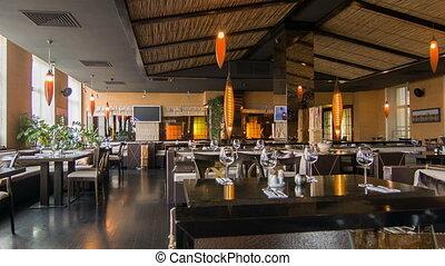 Horizontal dolly shot of popular modern design of nice restaurant