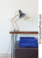 Modern design, interior room in the house, hotel with a lamp on the table, on towels