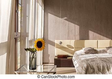 Modern designed bedroom interior with sunflower