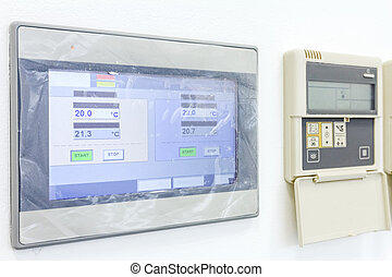 Modern digital electronic thermostat, climate control system.