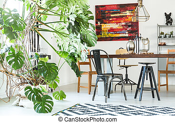 Modern dining room with monstera