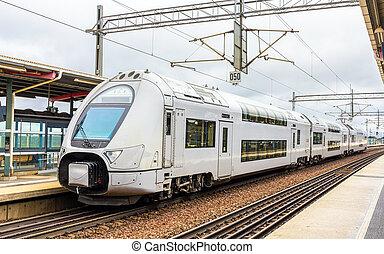 Modern double-decker train in Sodertalje syd station - Sweden