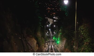 Modern driver-less metro train rush forward, along night...