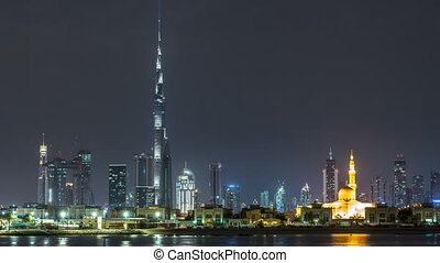 Modern Dubai city skyline timelapse at night with...