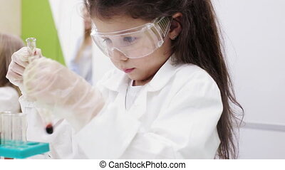 Modern education in school. chemistry lesson - Children do...