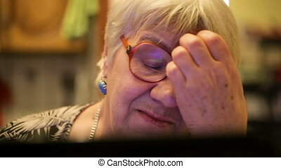 Modern elderly woman using skype - Close-up shot of elderly...