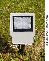 modern electric lamp on city park field