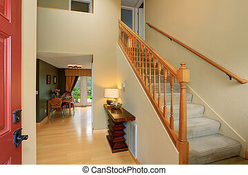 Modern entry way to home with carpet staircase.