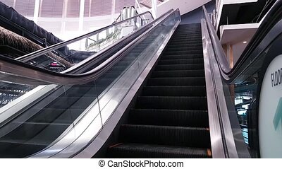Modern e scalator in the mall moving up