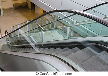 Modern escalator. Side view from top to down