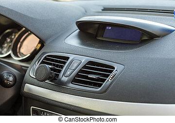 Modern expensive car interior. Dashboard in black color. Transportation, design, modern technology concept.