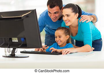 modern family using computer - happy modern family using...