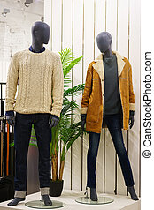 Mannequins in a modern fashion store.