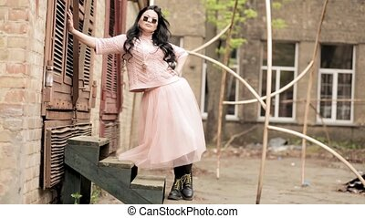 Modern fashion mid aged model posing for photographer - ...