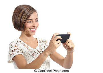 Modern fashion woman watching video in a smart phone