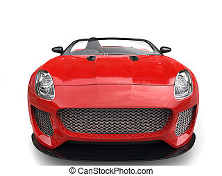 Modern fast raging red convertible sports car - front view closeup shot