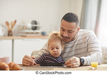 Modern Father Using Digital Tablet with Cute Little Girl