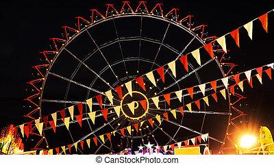 Modern ferris wheel in the night, amusement park