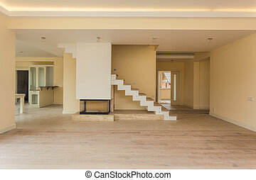 Modern fireplace in new unfinished empty house construction