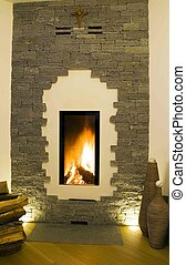 Modern stone fireplace with flame