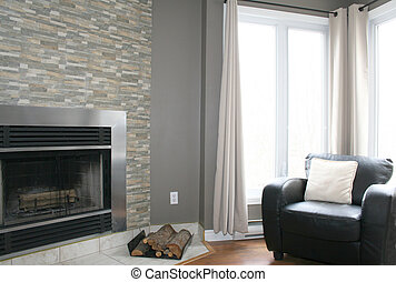 Modern fireplace with leather chair and large windows