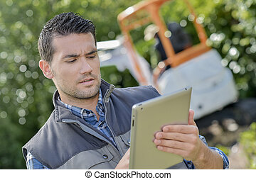 Modern foreman using a tablet computer